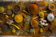 Assortment of spices in wooden bowl background stock photo