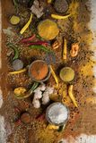 Assortment of spices in wooden bowl background stock photos
