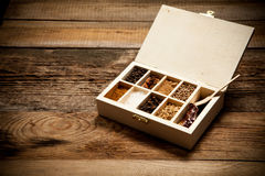 Assortment of spices in wooden box Royalty Free Stock Images
