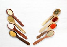 Assortment of spices in wooden spoons stock photo
