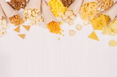Assortment spicy colorful mexican snacks in paper cone on white wooden board. Stock Image
