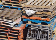 Assortment of Stacked Pallets Outside Stock Photos
