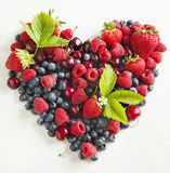 Assortment of summer fresh berries in the shape of heart Royalty Free Stock Images