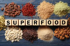 Assortment of superfood products with cubes. On wooden background, top view stock photo