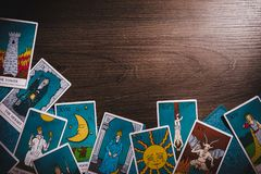Tarot cards on a wooden background royalty free stock photos