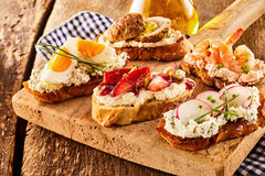 Assortment of tasty bruschetta appetizers Royalty Free Stock Photo