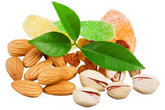 Assortment of tasty nuts with leaves Stock Photos