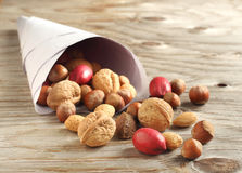 Assortment of tasty nuts in a paper bag Stock Photography