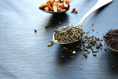 Assortment of teas on a teaspoon Royalty Free Stock Photos