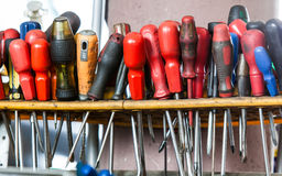 Assortment of tools hanging on wall. Screwdrivers in mechanic garage car service Royalty Free Stock Image
