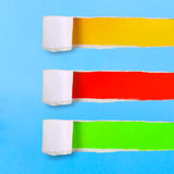 Assortment torn of ripped blue green yellow red Royalty Free Stock Photography