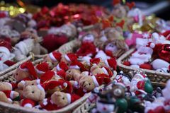Assortment of toy decoration for the Christmas tree in baskets in store stock photos