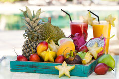 Assortment of tropical exotic fruits with smoothie and fresh juice Royalty Free Stock Photography