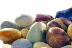Assortment of tumbled beach pebbles studio shot against white ba Stock Photography