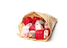Assortment  turkish delight in  paper bag isolated on white Stock Photos