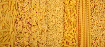 Assortment of uncooked Italian pasta as background Stock Image