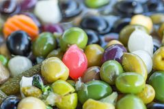 Assortment Variety of Handmade Artisanal Antipasti Tapas Brine Cured Olives with Herbs Pearl Onions Vegetables. Mediterranean. Assortment Variety of Handmade Stock Photo
