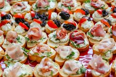 Assortment of various bruschetta, with spread and meat Stock Image