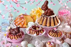 Assortment of various ring cakes for easter on festive table Stock Image