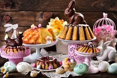 Assortment of various ring cakes for easter on festive table Royalty Free Stock Images