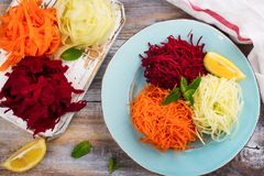 Vegetables noodles. Homemade raw fresh zucchini, carrot and beet root pasta. Assortment of vegetables noodles. Homemade raw fresh zucchini, carrot and beet root Royalty Free Stock Photography