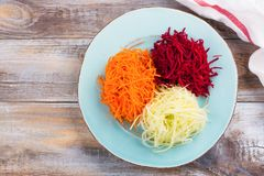 Vegetables noodles. Homemade raw fresh zucchini, carrot and beet root pasta. Assortment of vegetables noodles. Homemade raw fresh zucchini, carrot and beet root Stock Photography