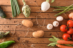 Assortment vegetables on wood table top view Stock Image