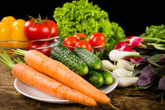 Assortment of vegetables on wooden table Stock Photos