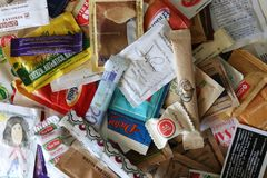 Assortment of white and brown sugar sachets stock image