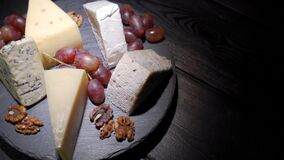 An assortment of wine appetizers, appetizers or gourmet dinners. Top view, close distance, a wedge of cheese, on a rare