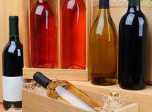 Assortment of wine bottles on crates Royalty Free Stock Images
