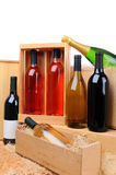 Assortment of wine bottles on crates Stock Photos