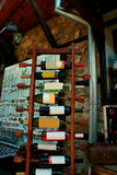 Assortment of Wines on Wine Rack. Red  and wite wine bottles stacked on wooden racks shot with Stock Image