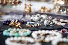 Assortment of women`s jewelry market Stock Photos