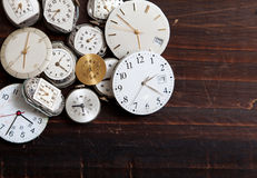 Assortment of wrist watch faces on a wood Royalty Free Stock Photo