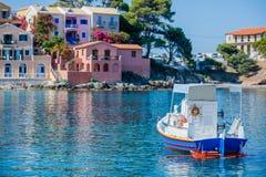 Assos beach in Kefalonia, Greece. Beautiful boat in Assos in island Kefalonia, Greece Royalty Free Stock Images