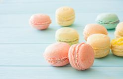 Assotrment of macarons on blue wood background. Assorment of colorful homemade  macarons on blue wood background. Close up. Selective focus Royalty Free Stock Photo