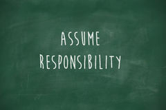 Assume responsibility handwritten on blackboard Stock Photo