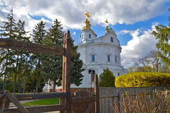 Assumption Cathedral in Poltava, Ukraine. Wooden carved gates at Royalty Free Stock Image