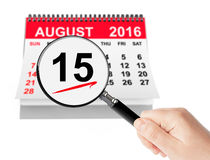 Assumption of Virgin Mary Day Concept. 15 August 2016 calendar w. Ith magnifier on a white background Stock Photography