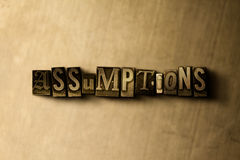 ASSUMPTIONS - close-up of grungy vintage typeset word on metal backdrop Stock Photos