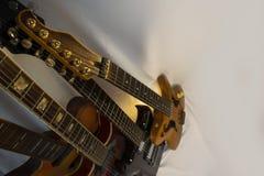 Assuré quatre guitares Photographie stock libre de droits