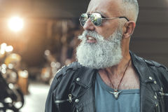 Assured aged biker in goggles Stock Photography