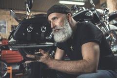 Assured aged man in garage Stock Photos