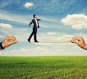 Assured businessman walking on the rope Stock Image