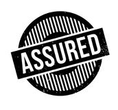 Assured rubber stamp. Grunge design with dust scratches. Effects can be easily removed for a clean, crisp look. Color is easily changed Stock Photography