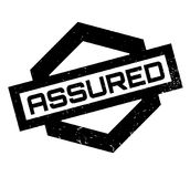 Assured rubber stamp. Grunge design with dust scratches. Effects can be easily removed for a clean, crisp look. Color is easily changed Stock Images