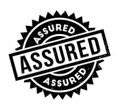 Assured rubber stamp. Grunge design with dust scratches. Effects can be easily removed for a clean, crisp look. Color is easily changed Stock Photo