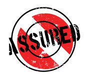 Assured rubber stamp. Grunge design with dust scratches. Effects can be easily removed for a clean, crisp look. Color is easily changed Stock Image