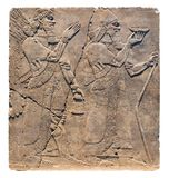 Assyrian art on the wall, King Ashurnasirpal II and genius. royalty free stock photos
